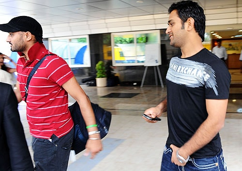 Harbhajan Singh and India captain Mahendra Singh Dhoni leave the BCCI headquarters in Mumbai after an emergency session to discuss the players' refusal to sign the clause with WADA. (AFP Photo)
