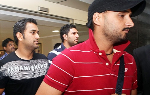 Harbhajan Singh and Yuvraj Singh walk with MS Dhoni as they leave the BCCI headquarters in Mumbai after an emergency session to discuss the players' refusal to sign the clause with WADA. (AFP Photo)