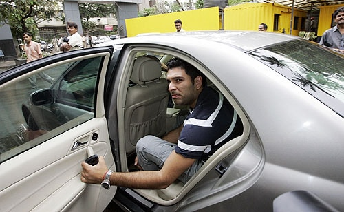 Yuvraj Singh leaves the head office of the BCCI after the meeting in Mumbai. India's cricket board on Sunday rejected WADA's rule that requires details about the location of players three months in advance, allowing random out-of-competition testing. (AP Photo)