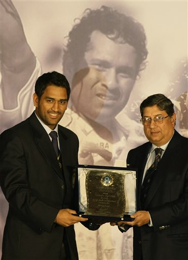Indian cricket captain Mahendra Singh Dhoni receives an award from Board of Control for Cricket in India (BCCI) Secretary N Srinivasan at the board's annual awards in Mumbai on Wednesday, February 18, 2009. (AP Photo)