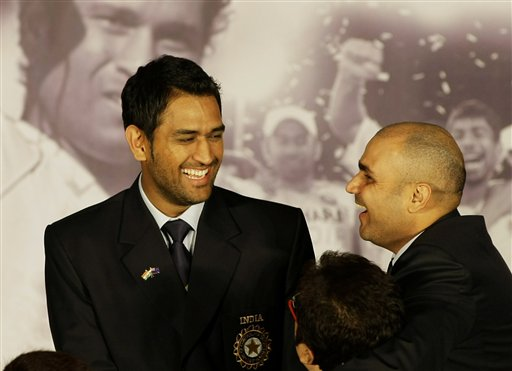 Indian cricket team captain Mahendra Singh Dhoni and vice-captain Virender Sehwag interact after the Board of Control for Cricket in India (BCCI) annual awards in Mumbai on Wednesday, February 18, 2009. (AP Photo)