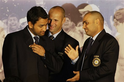 Indian cricket team captain Mahendra Singh Dhoni, coach Gary Kirsten and vice-captain Virender Sehwag interact after the Board of Control for Cricket in India (BCCI) annual awards in Mumbai on Wednesday, February 18, 2009. (AP Photo)