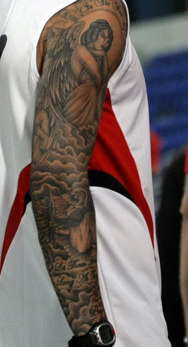 "Along with the cross on his neck, Becks got an Angel on his right arm with the motto ""In the Face of Adversity""."