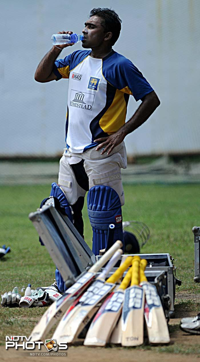 <b>Can't get enough</b>: It seems that Sri Lanka skipper Mahela Jayawardena is still unsure as to which bat will he use cometh the final. He is seen here in a mini-break during an extensive practice session for the Lankans.