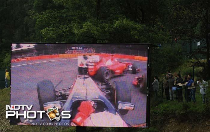 A big screen replay shows an on-board camera filming a crash between Scuderia Toro Rosso's Spanish driver Jaime Alguersuari and Virgin Racing's German driver Timo Glock.