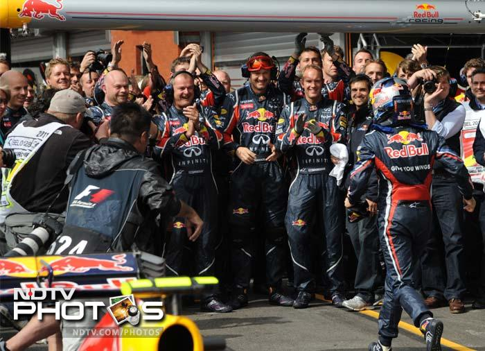 The big-winner though was Vettel as he can be seen rushing to his team after winning the race, here.