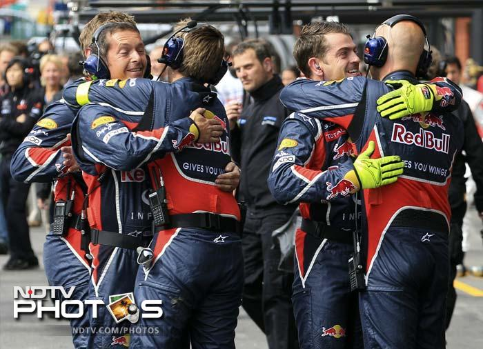 Red Bull team members celebrate a 1-2 finish as Mark Webber came in second to make it an emphatic win for the team.