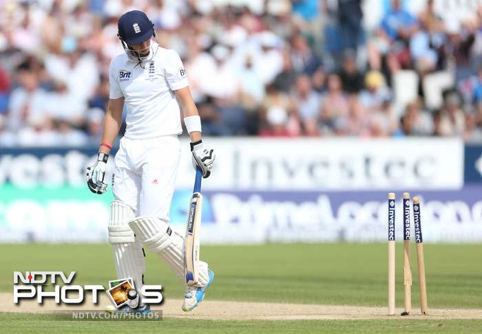 Ian Bell's third hundred of this Ashes series rescued England from another top-order collapse and left them well-placed at stumps on Sunday's third day of the fourth Test at Chester-le-Street. Joe Root bowled by Ryan Harris here. (All AFP and AP images)