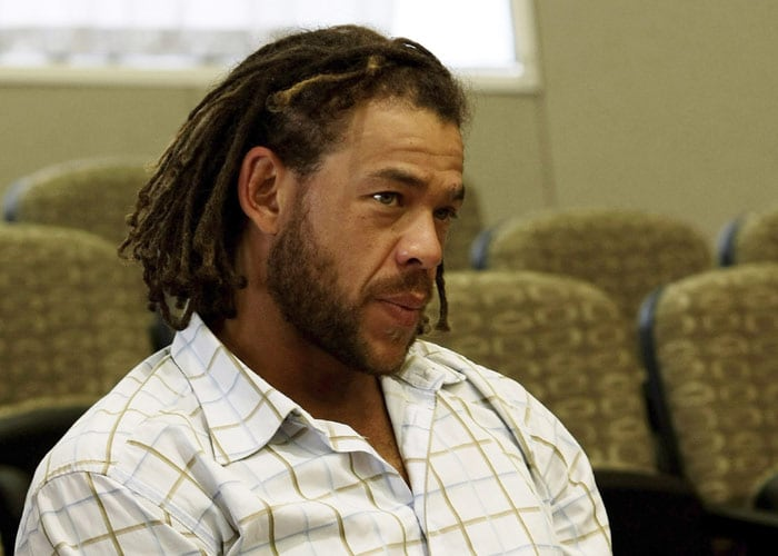<b>In waiting:</b> Australian cricketer Andrew Symonds sits in the courtroom prior to the start of the appeal hearing.