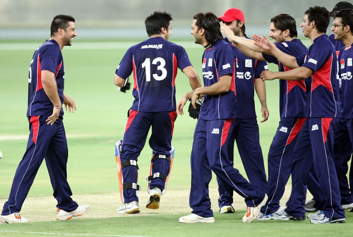 Bollywood actors celebrate the dismissal of Shaikh during the celebrity Cup match. (AP Photo)