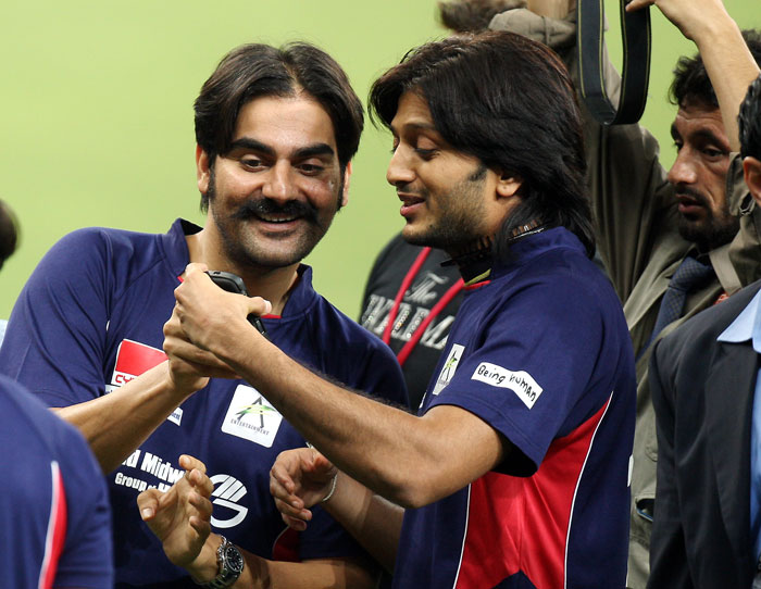 Bollywood actor Arbaaz Khan and Ritesh Deshmukh at the sports city before the start of the cricket match. (AP Photo)