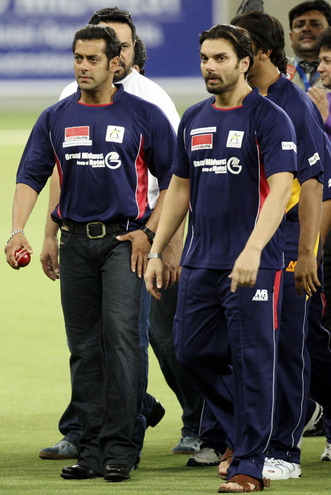 Bollywood actor Salman Khan and Sohail Khan are seen on the field before the start of the cricket match to raise money for charity. (AP Photo)