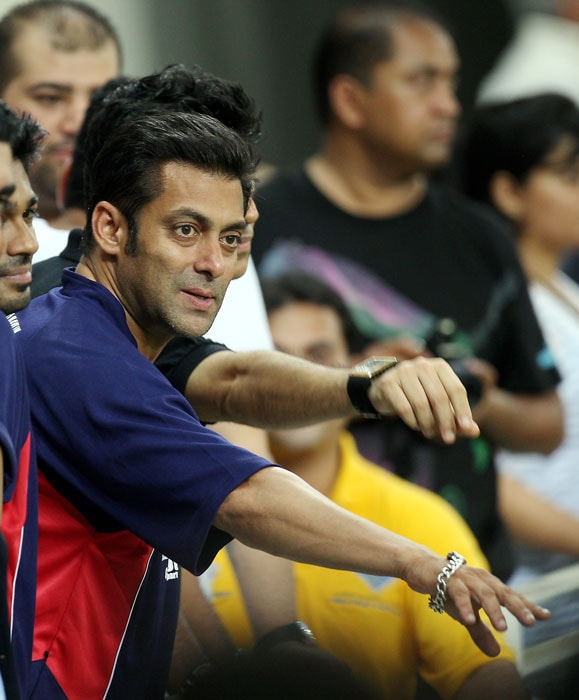 Bollywood actor Salman Khan watches his team play during the celebrity cup held at the sportscity in Dubai.(AP Photo)