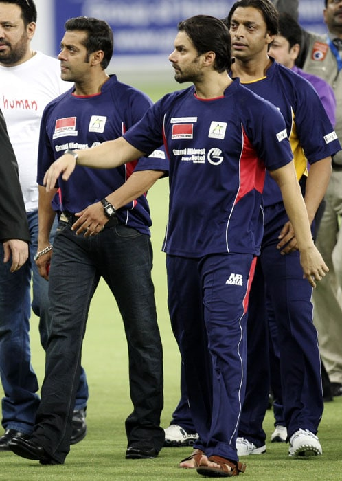Bollywood actors Salman Khan,Sohail Khan and Shoiab Akhtar seen walking together before the start of the match. (AP Photo)