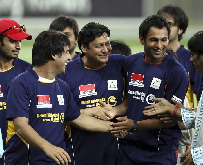 Pakistani Cricketer Shoaib Malik is seen with his teammates during the celebrity cricket match. (AP Photo)