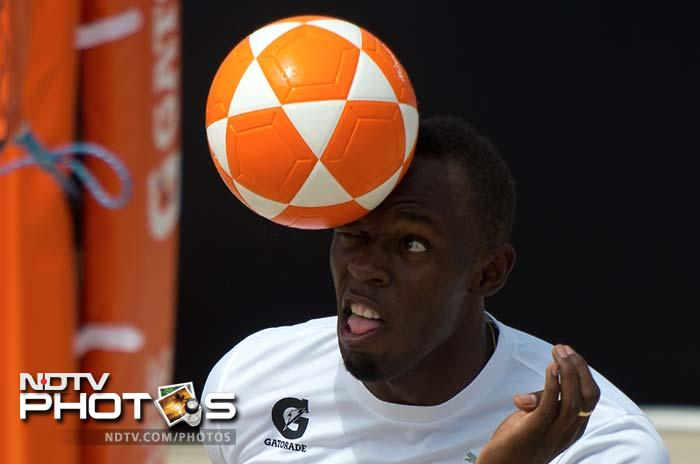 Different sport different techinque - Usain Bolt trying his hands on foovolley