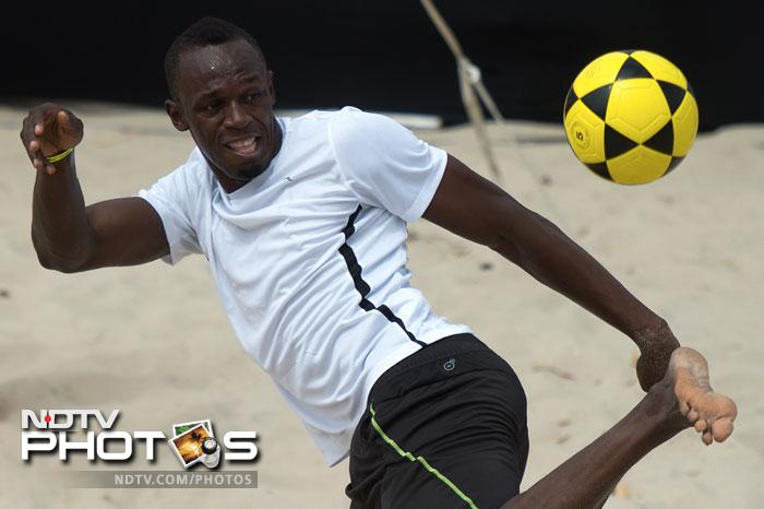 Usain Bolt, the two-time reigning Olympic champion plays foovolley at Copacabana beach
