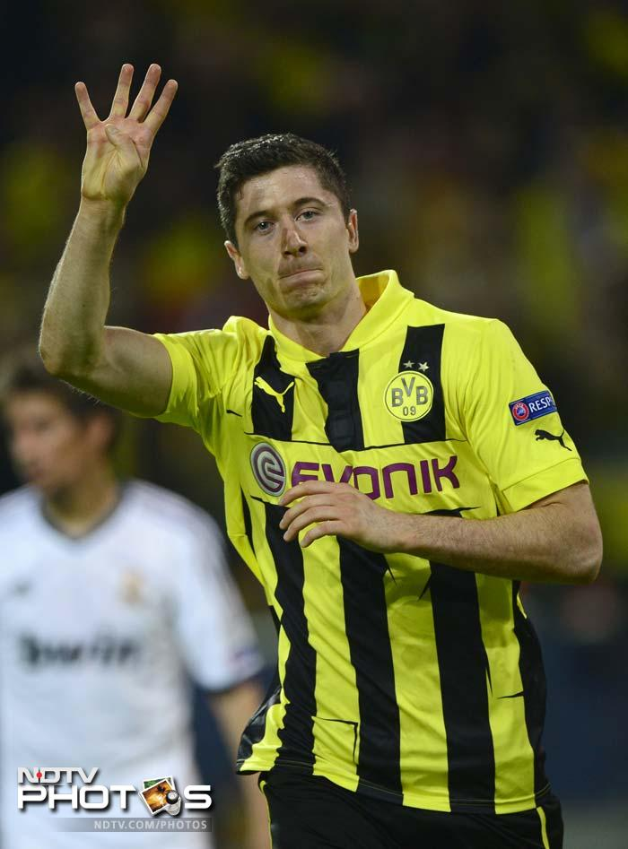 With Dortmund fans in delirium, Lewandowski claimed his fourth of the night when Reus was fouled in the area by Xabi Alonso, after Goetze's through-ball, and there was only one candidate when Kuipers pointed to the penalty spot on 66 minutes.