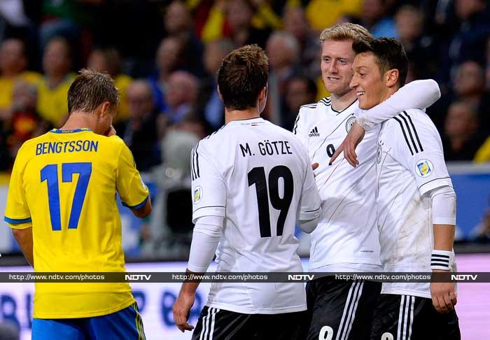 Chelsea's Andre Schurrle claimed a second-half hat trick as Germany came from two goals down to seal a 5-3 win away to Sweden.