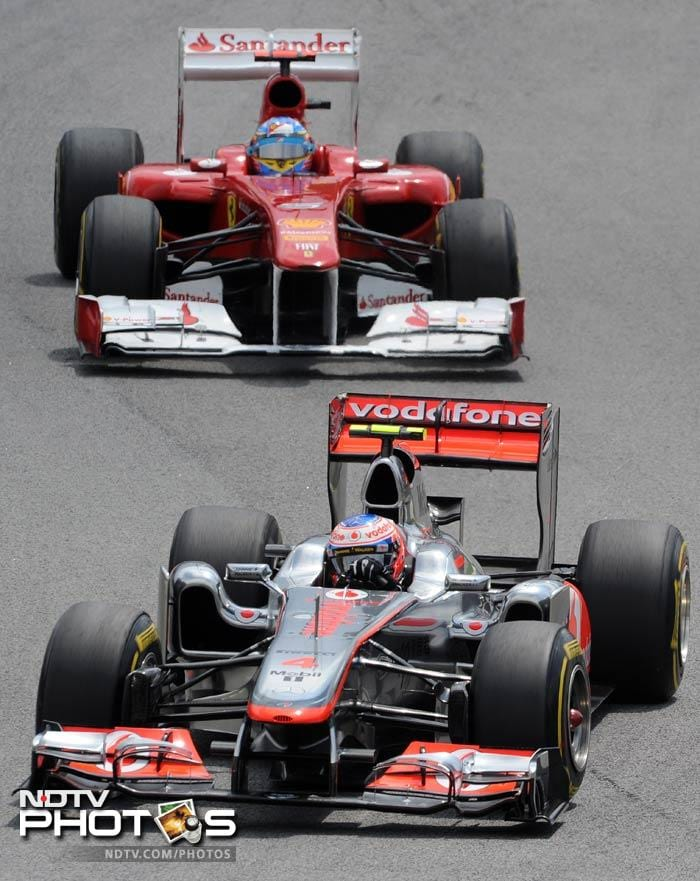 The race itself was fought hard by most of the drivers. Button is seen here, powering his McLaren ahead of Alonso in his Ferrari. Alonso finished the race fourth.