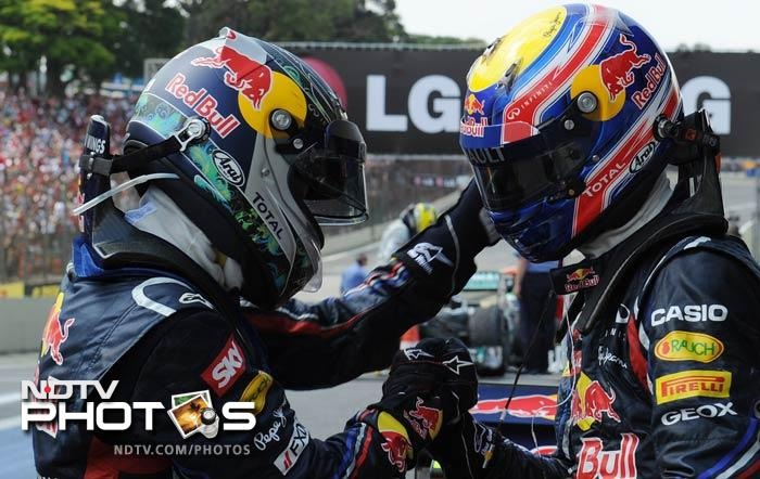 Webber had finished behind Vettel in the qualifying round. Jenson Button of McLaren, who finished third in Sao Paulo, wedged himself between the two Red Bulls in the final drivers standing for the season.