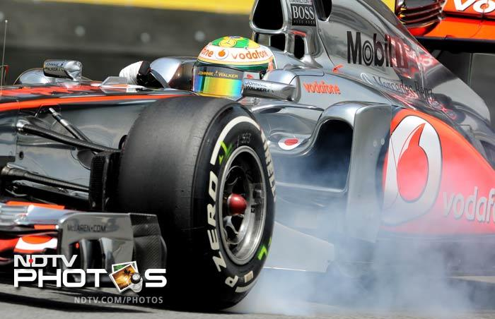 McLaren's Lewis Hamilton drives to the fourth position on the grid. He finished ahead of Fernando Alonso in his Ferrari.