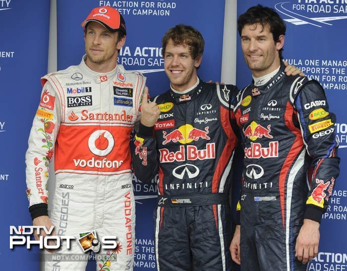 Vettel was followed by Red Bull teammate Mark Webber (r) and Jenson Button of McLaren.