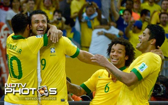 Spain offered some resistance in the second half but Fred's second goal of the match sealed their fate as Brazil cruised to a 3-0 win.