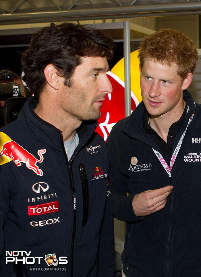 Prince Harry shares a conversation with Red Bull's Mark Webber, who had started the race in pole position.