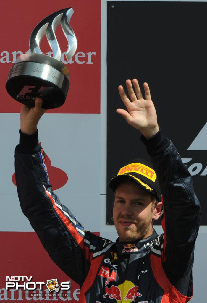 Vettel came home second for Red Bull ahead of his team-mate Australian Mark Webber - with Red Bull using team orders to stop Webber passing on the final lap.