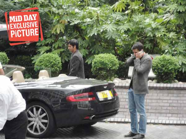 Mazhar Majeed speaking to someone on the phone outside the hotel hosting Pakistan's team. (Source: Mid-Day.com)