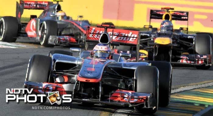 McLaren-Mercedes driver Jenson Button of Britain leads Red Bull-Renault driver Sebastian Vettel of Germany and team-mate Lewis Hamilton during Formula One's Australian Grand Prix in Melbourne.