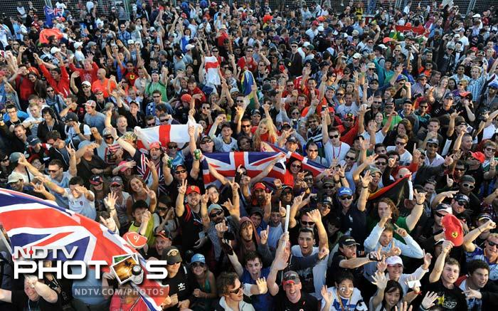British fans flood the track after McLaren Mercedes driver and former world champion Jenson Button of Britain took the chequered flag to win the Formula One's Australian Grand Prix in Melbourne.