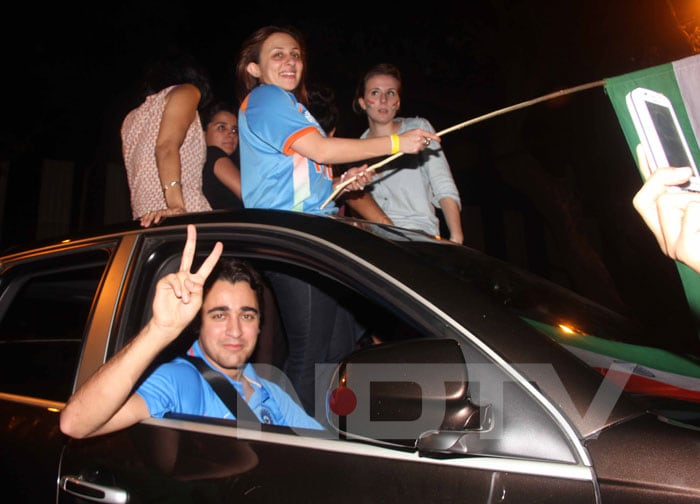 Imran was driving around Mumbai with a carload of friends rejoicing the World Cup coming to India after 28 years. His wife Avantika held the flag. <br>(Photo Courtesy: Varinder Chawla)