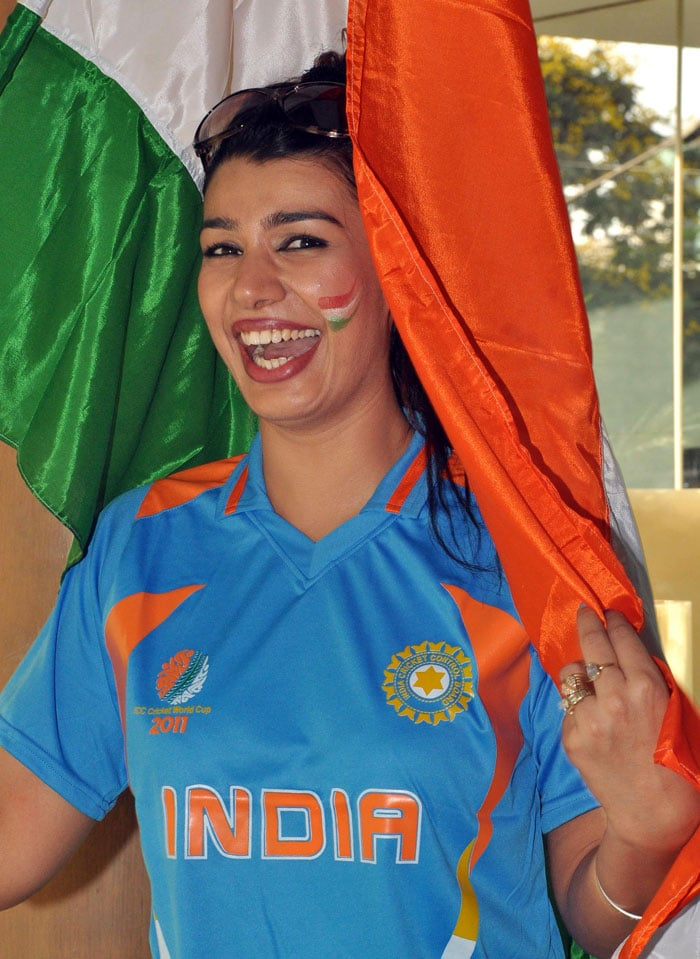 Mink plays peekaboo with the Indian flag. <br>(Photo Courtesy: AFP)