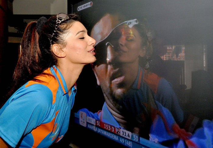 Mink gives Yuvraj Singh a kiss on her TV screen. <br>(Photo Courtesy: AFP)