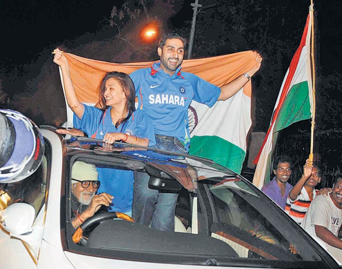 """The Bachchan family was about town celebrating the win, minus Jaya. Amitabh, Aishwarya and Abhishek took turns standing through the sunroof of their car and cheering for India. <br> <b>Source:</b>:<b><a href=""""http://mid-day.com"""" ;="""""""" style=""""color: rgb(0, 51, 153);"""">Mid-Day.com</a>"""
