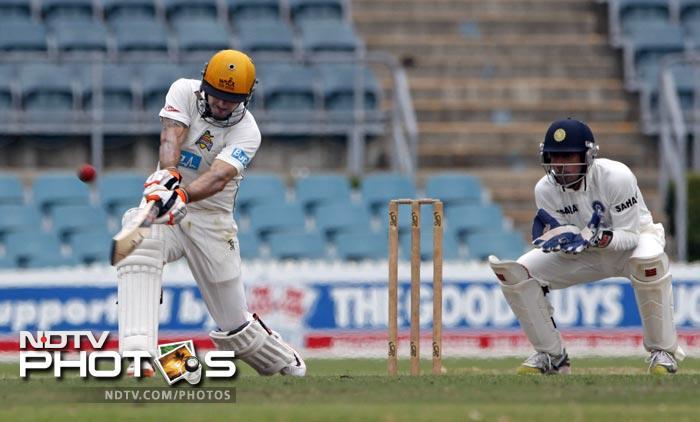 Wes Robinson (143) of the Cricket Australia Chairman's XI hits a shot.