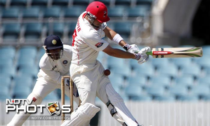 The Indian bowlers were given the first taste of what could be in store for them on the long tour of Australia. India took on Cricket Australia Chairman's XI in a two-day tour match and the bowlers ended the day with quite a hammering. (ALL AP Images)