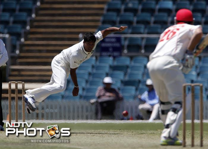 India's Umesh Yadav bowls a delivery to Tom Cooper of the Cricket Australia Chairman's XI during a two-day tour match.