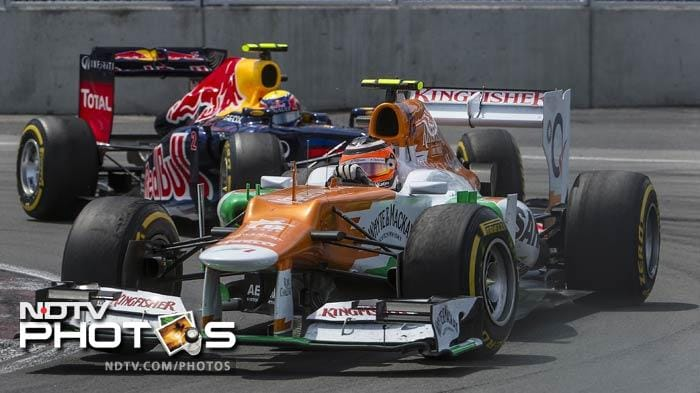 Sahara Force India driver Nick Hulkenberg leads in front of Red Bull Racing Renault driver Mark Webber of Australia in the hairpin curve at the Canadian Formula One Grand Prix at the Circuit Gilles Villeneuve in Montreal. (AFP Photo)