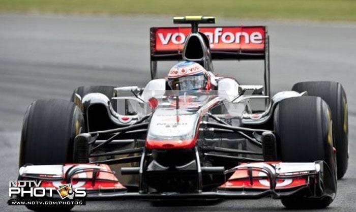 McLaren's British driver Jenson Button at seventh, qualified 2 spots behind team-mate Lewis Hamilton. (AFP PHOTO)