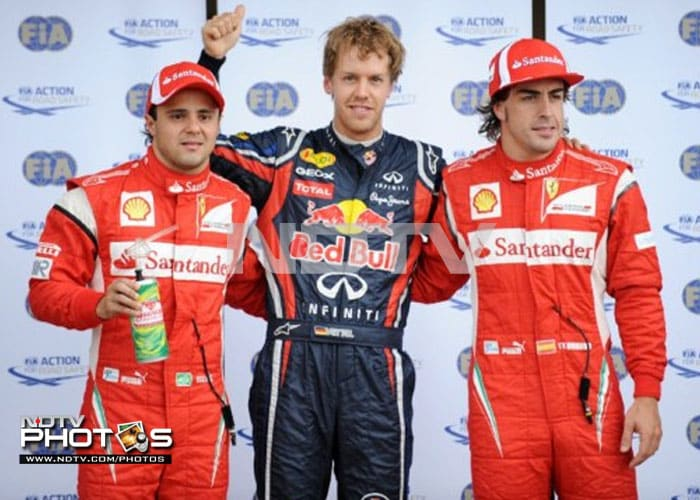 Vettel was joined on the starting grid by the Ferrari duo of Fernando Alonso of Spain (R) and Felipe Massa of Brazil (L) who finished the 2nd and 3rd fastest respectively. (AFP PHOTO)