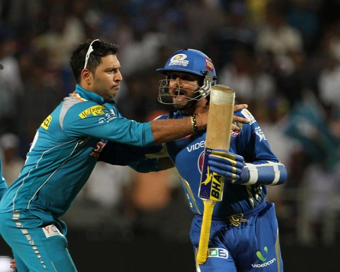 """Just won't let you take that single off my bowling!""<br><br>Pune's Yuvraj (left) jokes with Mumbai Indians' Harbhajan Singh during the course of their match at the Subrata Roy Sahara Stadium. (BCCI image)"