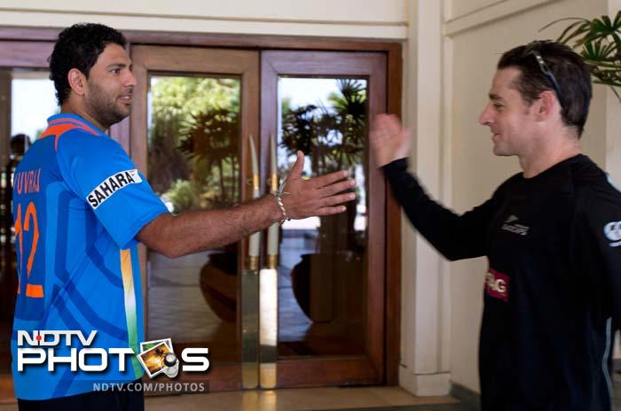 Old mates and mid-fives<br><br>India's comeback man - Yuvraj Singh - and New Zealand's Nathan McCullum give each other the palm as they caught up with each other in their hotel.