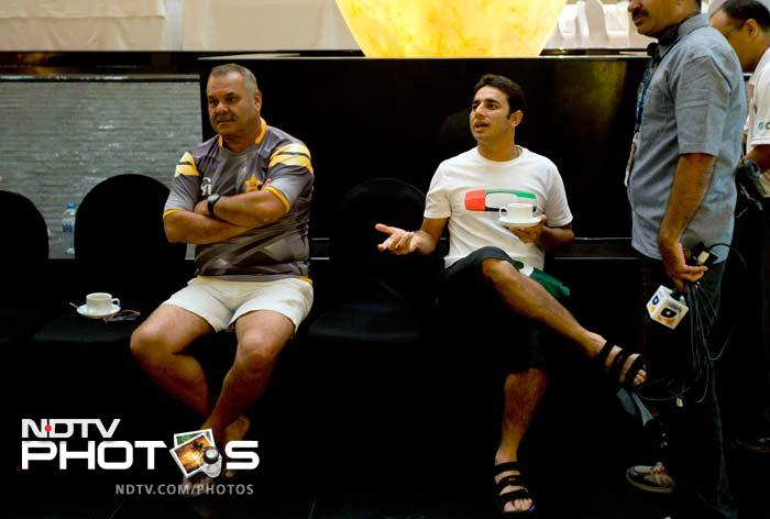 """""""Why I say. Why was I not in that list?""""<br><br> Pakistan's Saeed Ajmal gestures as coach Dav Whatmore looks on. Ajmal has been a power performer for his side in the international circuit but his name was missing from the ICC Awards list. It created a huge controversy."""