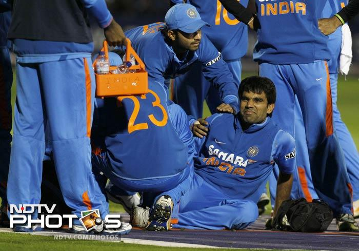 In between, India lost another player to injury when medium pacer Munaf Patel suffered a suspected ankle injury as he fell on the ground while chasing the ball. He had only bowled four overs for 26 runs and did not come out to bowl again.