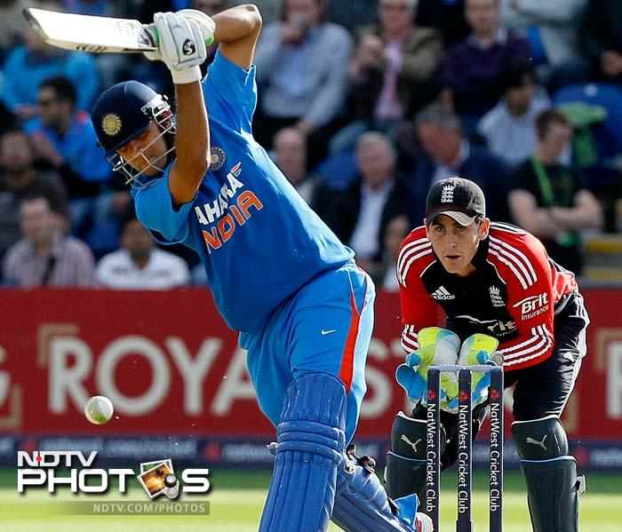 India faced England one last time in the 2011 tour, at Cardiff. It was also Rahul Dravid's last appearance in the blue jersey. A look at the day's play. (AFP and AP images)