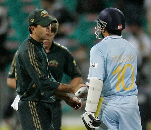 Ricky Ponting, left, congratulates Sachin Tendulkar after India won the first final of their tri-nations one-day international series in Sydney on Sunday, March 2, 2008. India won by six wickets with Tendulkar not out for 117 runs.