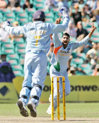 Harbhajan Singh, right, celebrates the fall of the wicket of Matthew Hayden during the first final of the tri-series one-day international series in Sydney on Sunday, March 2, 2008.